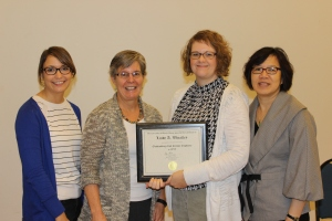 Lindy Wheatley with the Mortenson Center Staff, L-R, Rebecca McGuire, Susan Schnuer, Lindy,  Clara Chu