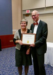 Susan Schnuer receives the 2015 Outstanding Academic Professional Award from John Wilkin